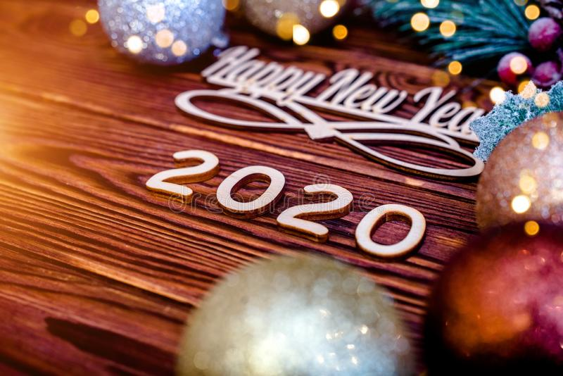 Happy new year 2020. On wooden brown background royalty free stock photo