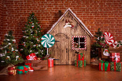 Christmas interior with wooden house, candy, tree and gifts. No people. Holiday background Stock Images