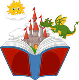 Story book with cartoon castle, dragon and sun Stock Photo